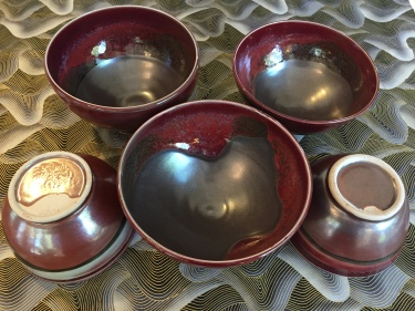 5 red ceramic bowls by Paul D. Goodman, October 2016