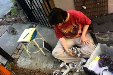 Paul D. Goodman sorting ceramics with Princess cat 17 July 2017